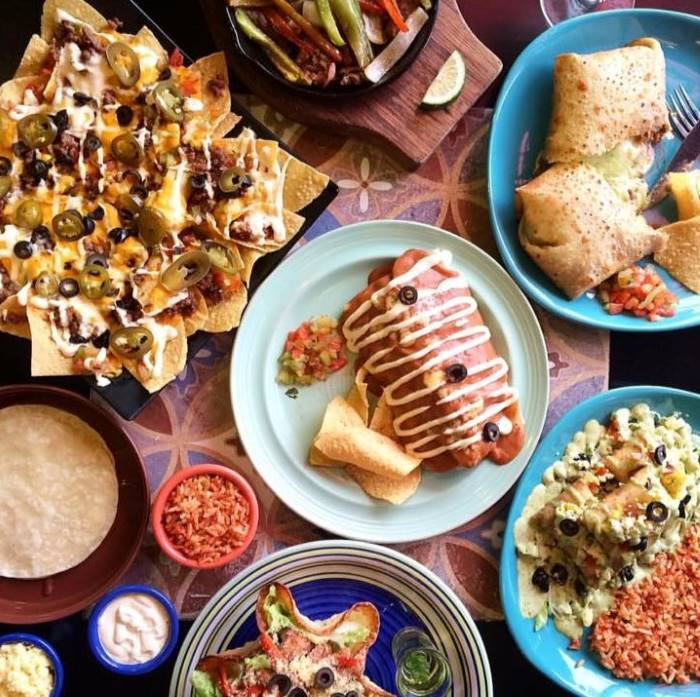 spanglish_table_of_food_nachos_burritos_enchiladas